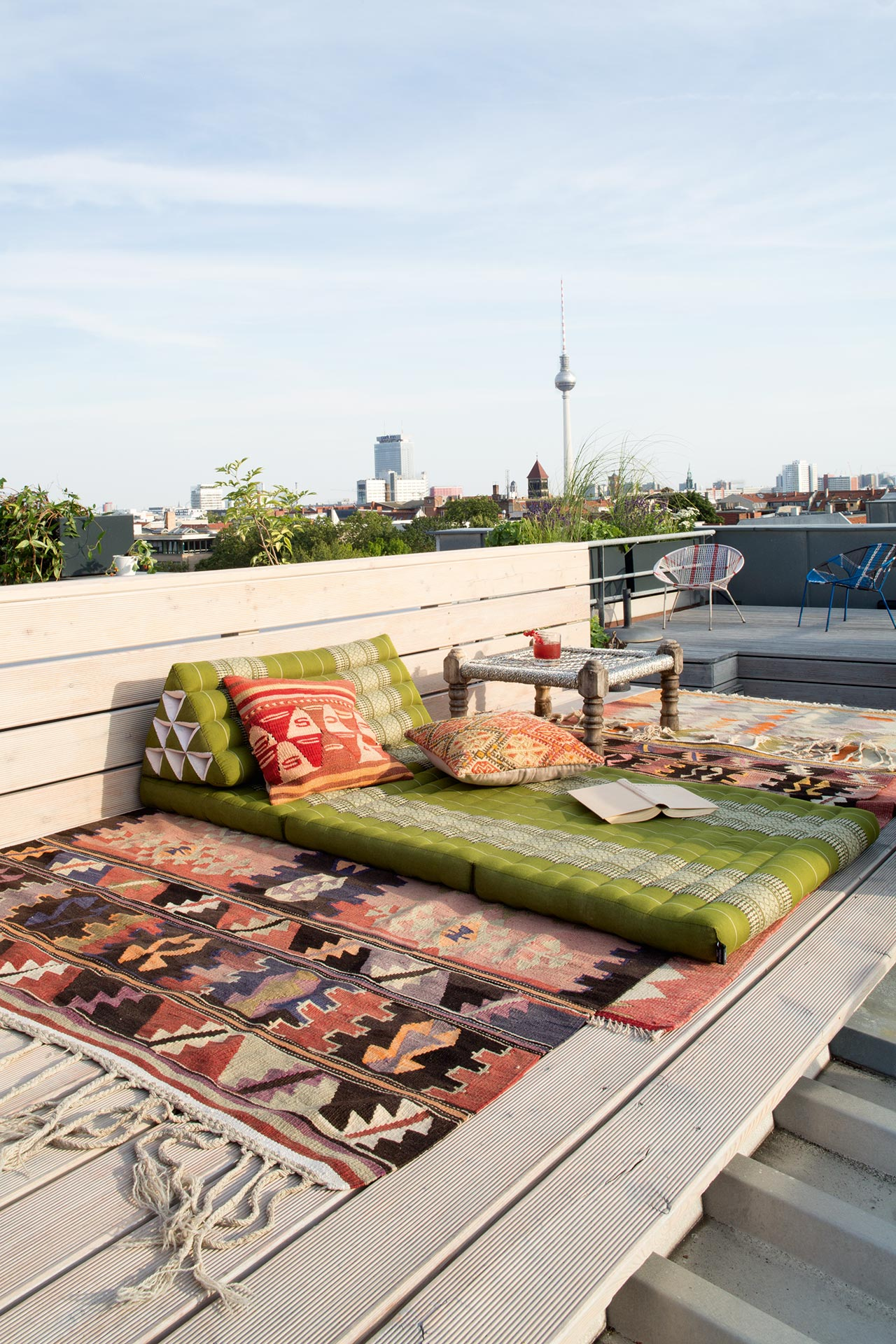 The terrace features a boho space for relaxing and a sitting space