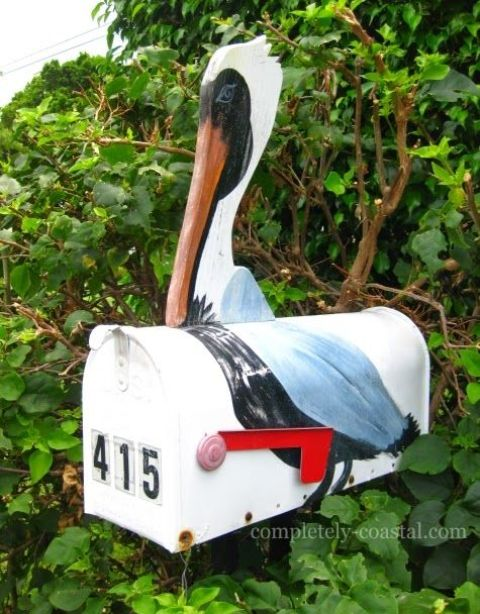 a bright pelican mailbox with house numbers is a cool idea for a coastal or beach home and it looks veyr eye catchy