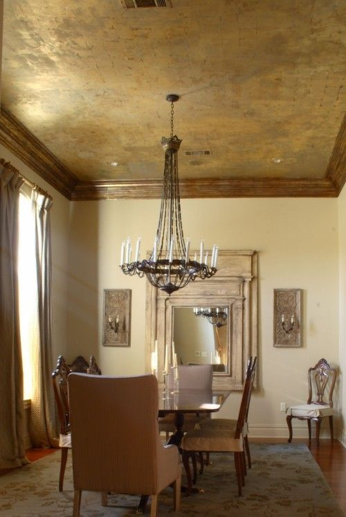 a gold metal ceiling with a rough feel and framing is a gorgeous way to accent a vintage space