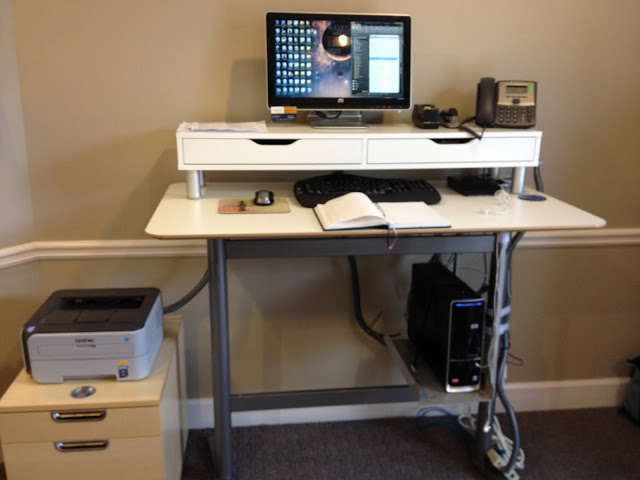 a modern standing workstation with an Ekby Alex unit put on it to make a standing desk