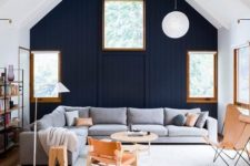 10 a navy wooden statement wall dominates over the space, the rest wood surfaces are light-colored