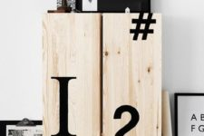 10 an IKEA Ivar cabinet decorated with black typography looks very bold and modern