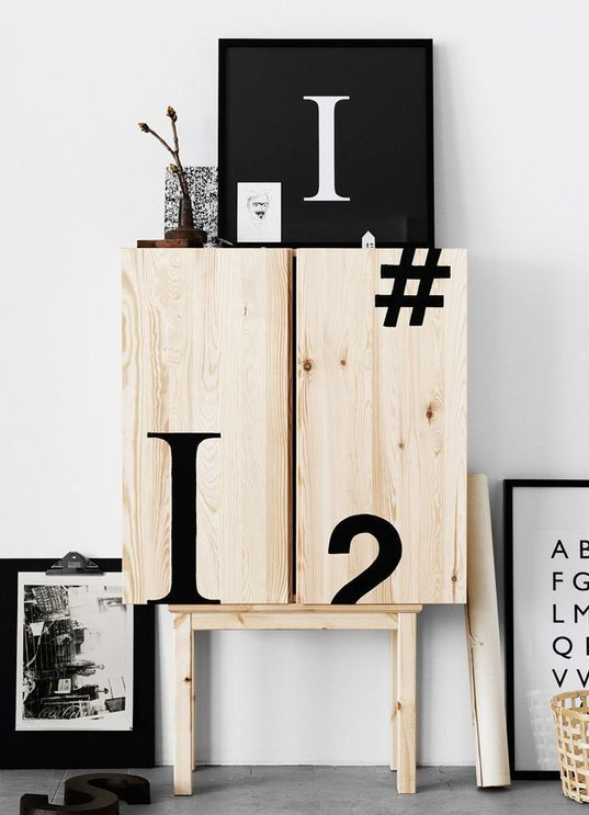 an IKEA Ivar cabinet decorated with black typography looks very bold and modern