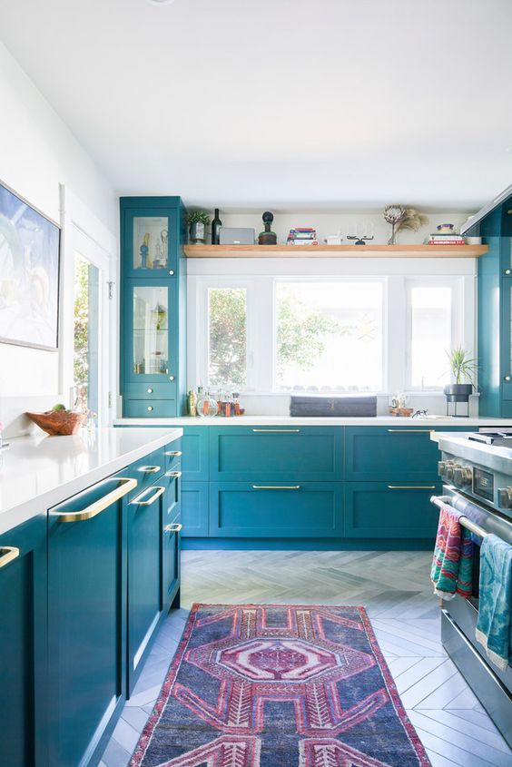 bright blue with gold touches will give your kitchen a new life, and white countertops create a contrast