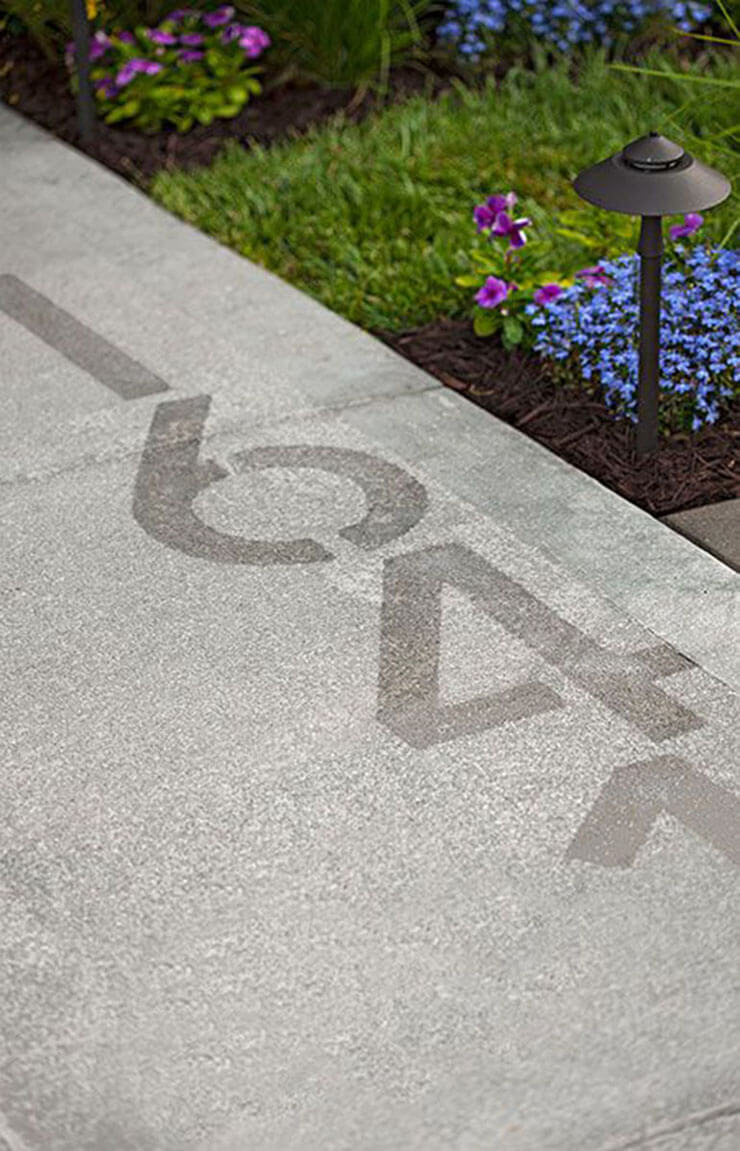 house numbers stenciled into the side walk is a simple and very modern idea, which fits contemporary and minimalist homes