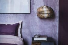 10 lilac plaster walls and touches of deep purple make up a bold and ultra modern bedroom