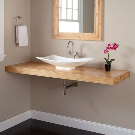such a simple floating vanity can be easily DIYed and doesn't require much space