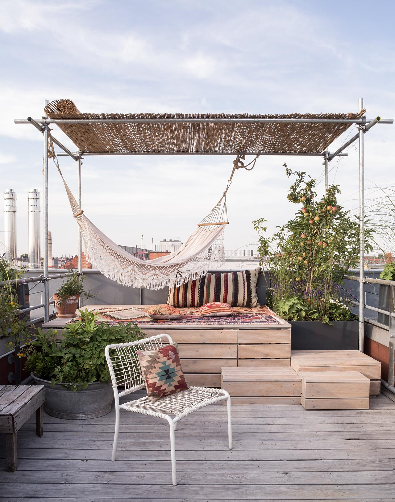 The other terrace shows off a hammock, a pallet space and much greenery