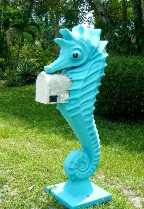 a bright turquoise seahorse mailbox is a bold and whimsy idea for a coastal or beach home