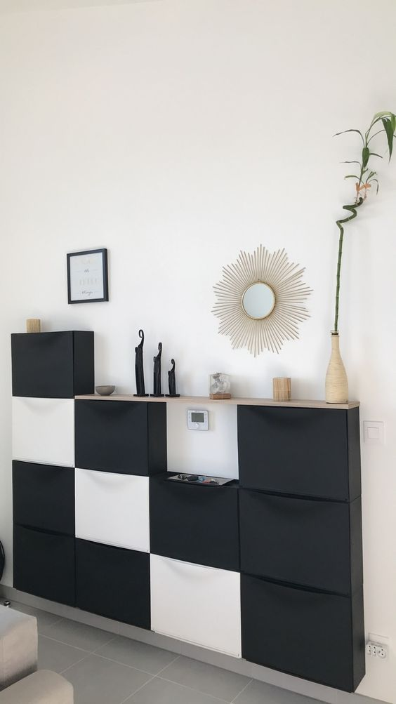a living room console made of IKEA shoe cabinets
