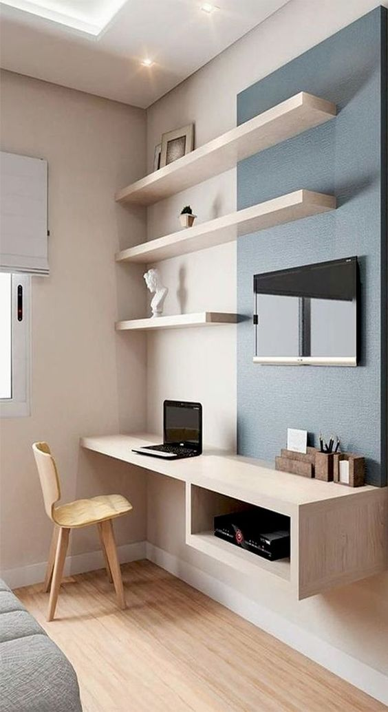 a floating deks is a nice idea for a small nook, this one also features some storage