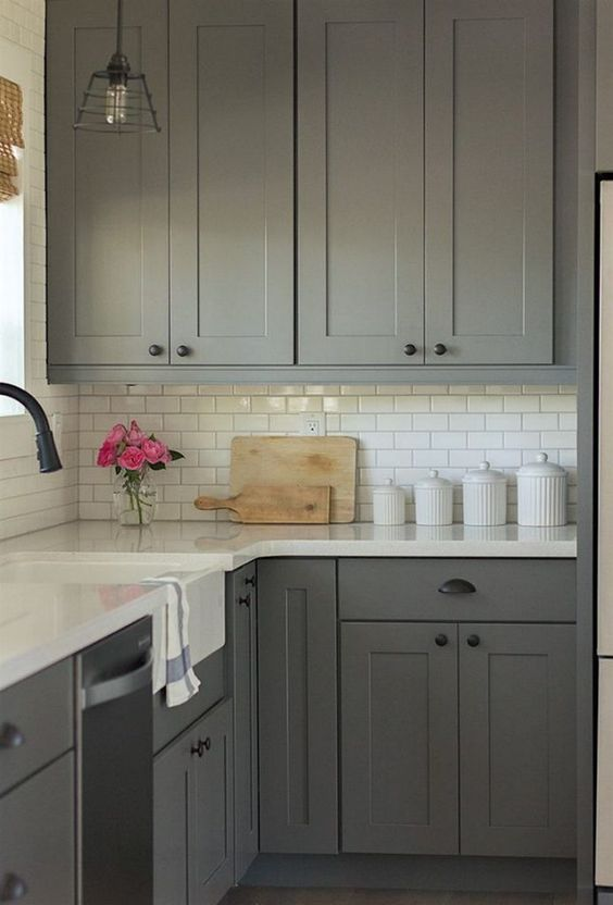a grey kitchen with white countertops is timeless classics that always works