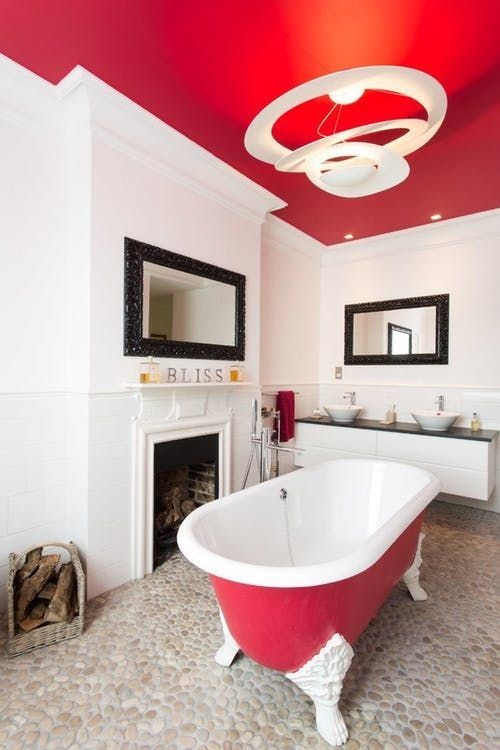 a hot red ceiling and an echoing bathtub make the space bold and add personality to it at once