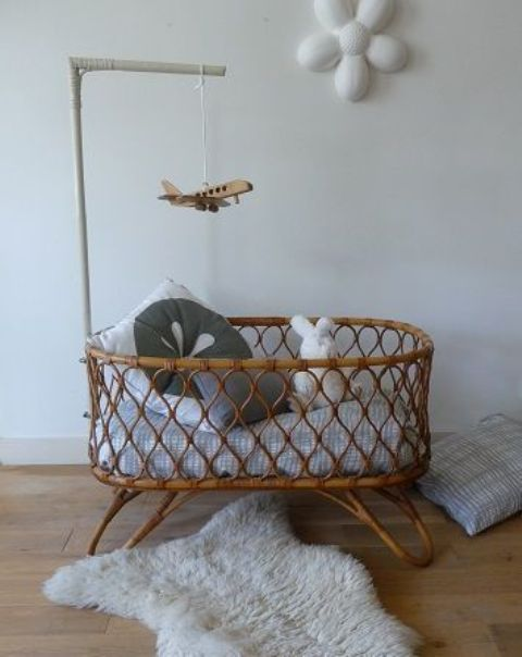 a rattan cradle is a cool boho inspired idea, which will make a stylish statement in your nursery