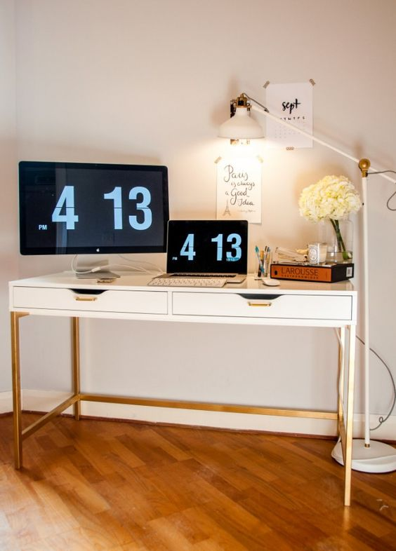 a stylish modern desk of an Ekby Alex unit, gold hangles and a gold leg base for a contemporary office