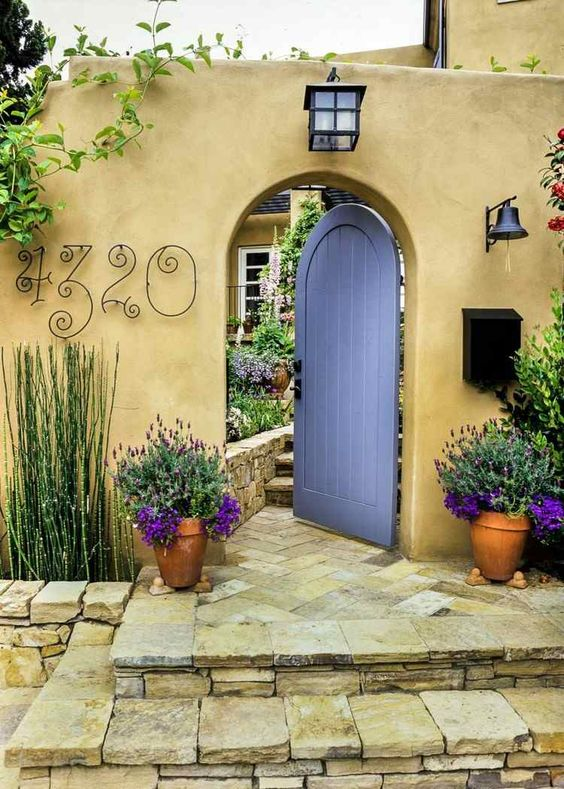 forged house numbers placed on the fence of your home is a stylish and chic idea to go for