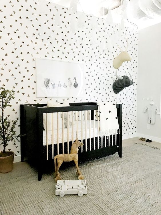 a bold and chic black and white crib is a statement idea for a monochromatic nursery like this one