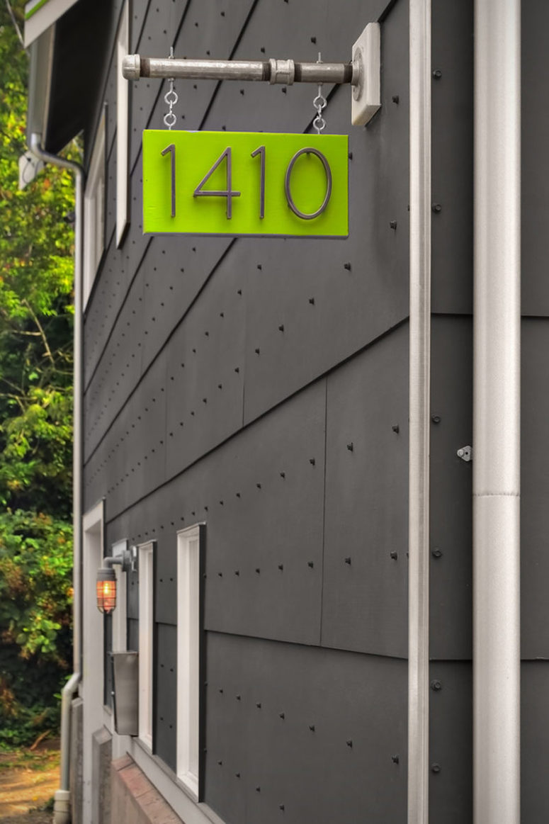 a bright hanging plaque displays your house number and adds a stylish pop of color to your exterior