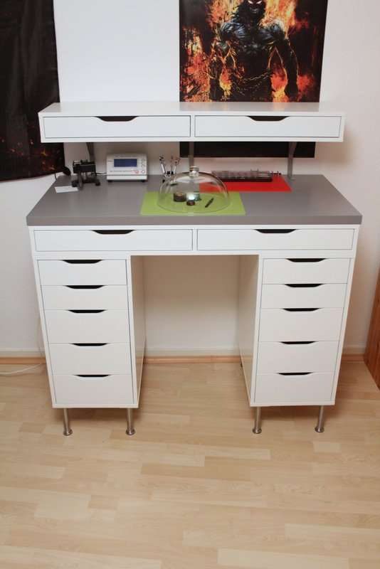 an Alex desk made standing with an additional Ekby Alex unit on top