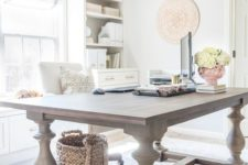 12 an oversized rustic vintage table used as a desk looks very contrasting to the modern home office