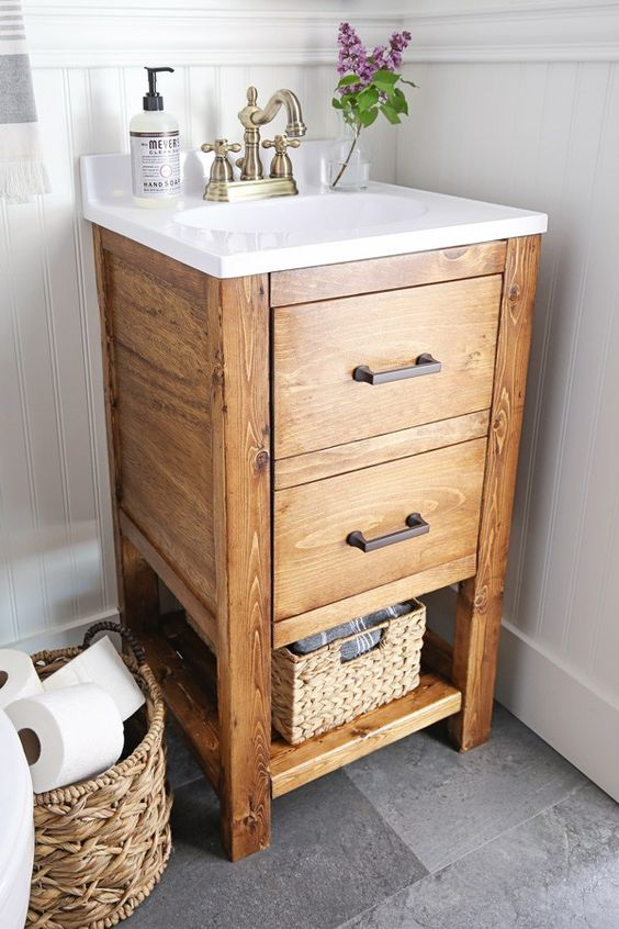 this little wooden vanity with much open storage and drawers is a great idea for a small nook