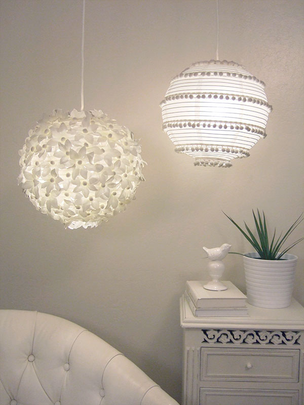 a duo of chic pendant lamps, a flower one and a boho pompom one, both made of IKEA Regolit lampshades