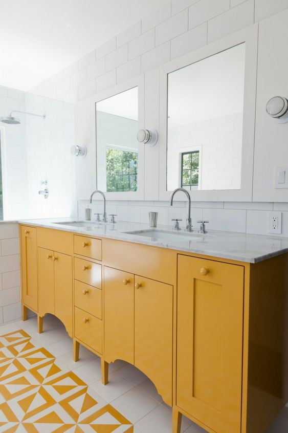a sunny yellow vanity with cutouts is a simple yet stylish idea with a stone countertop