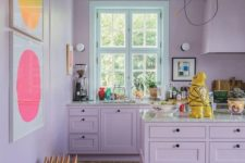 13 a tender lilac kitchen with bright abstract artworks is a very girlish and welcoming space