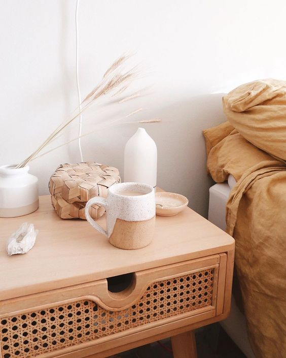 a wooden bedside table with rattan will give a slight outdoor feel to your indoor bedroom