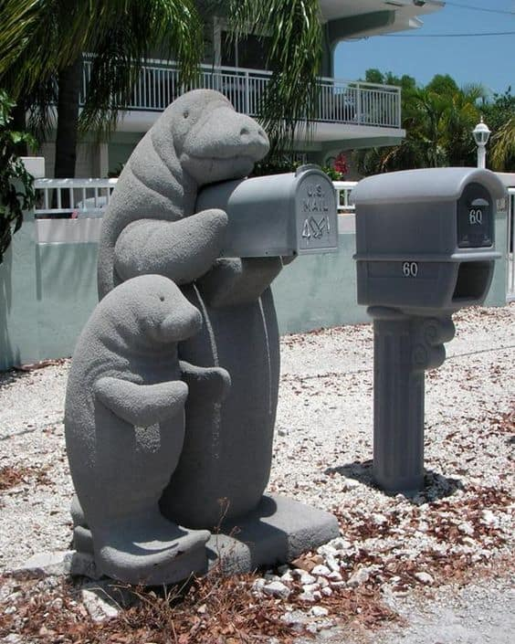 fun seal figurines holding the mailbox is a very fun and welcoming idea, your guests will never forget that