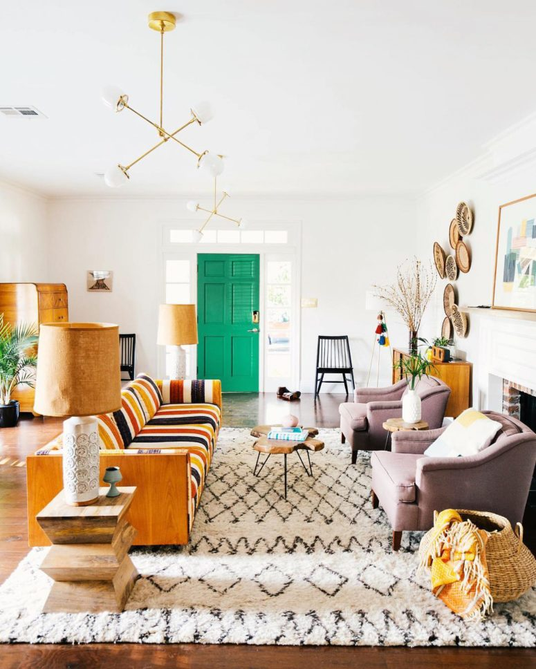 a bright mid-century modern living room with a duo of lilac chairs that feature muted colors