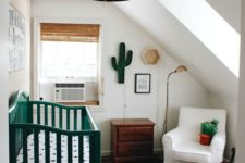 14 a crib painted emerald changes the look of the nursery, and emerald accessories add a vivacious touch