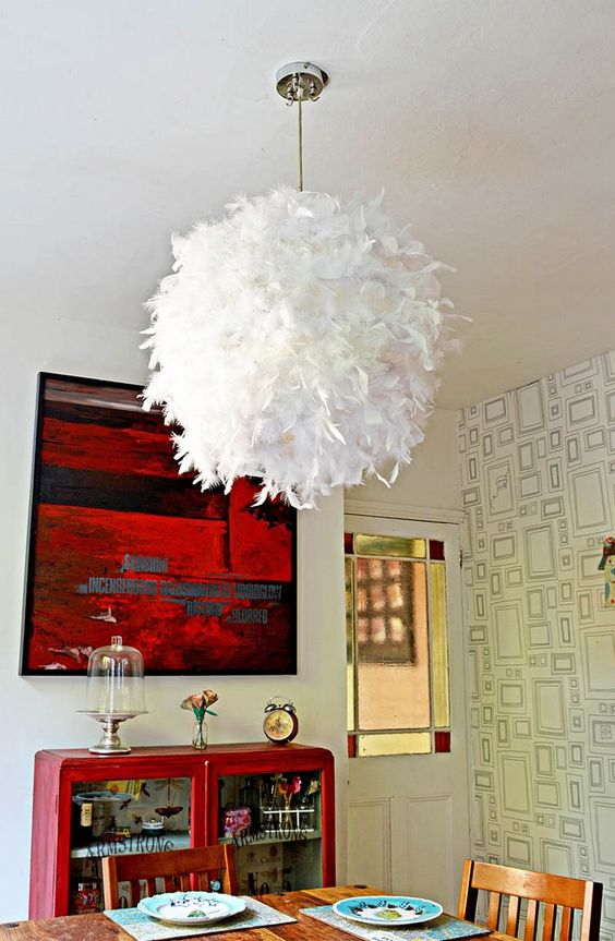 a feather lampshade made of an IKEA Regolit lampshade to add a touch of glam and softness to your space