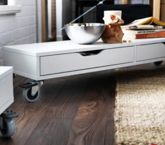 an Ekby Alex shelf on casters can become a rolling coffee table for a modern living room