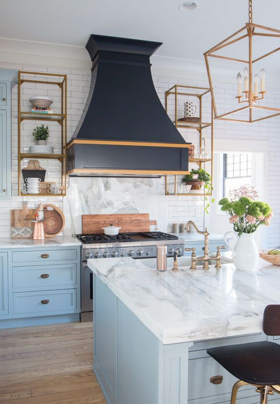 marble-inspired white stone countertops give a light and airy feeling to the kitchen