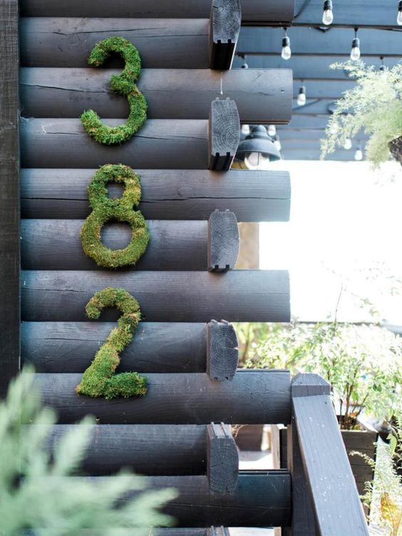 moss house numbers on the wall are a nice idea for a rustic house, it's a beautiful natural touch you may go for