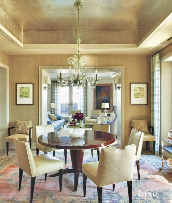 a neutral contemporary living room spruced up with a gold ceiling that adds shine to your space