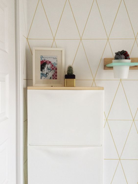 a simple IKEA Trones hack with a light colored wooden tabletop makes up a floating console table