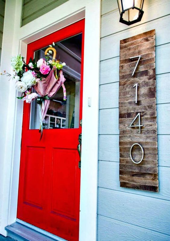 a wooden sign with numbers isn't only a mid century modern but also rustic decoration for your home