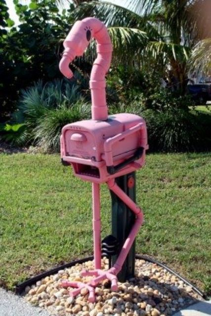 an industrial pink flamingo mailbox is a gorgeous idea for a southern place, and it's a fresh take on famous bird decor