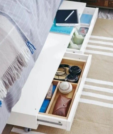 place an Ekby Alex shelf on casters and roll it under the bed to use for storage