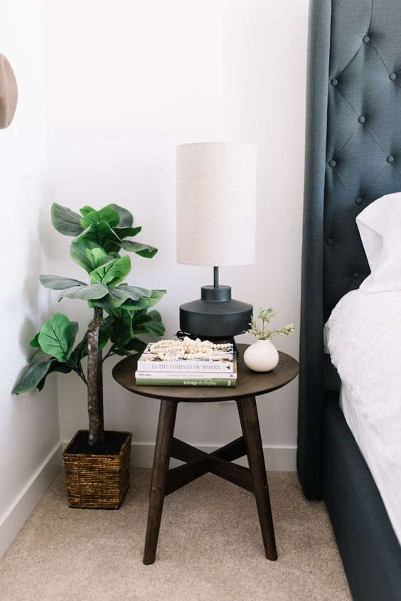 throw away your old bedside table and place a stool instead - you don't need any special nightstands