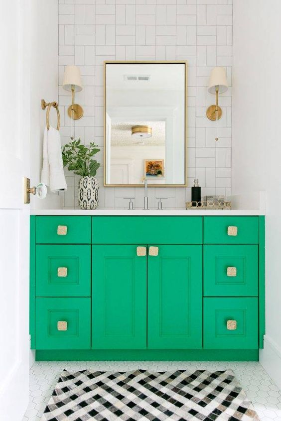 a bright green vanity with square handles and brass touches is a super bold idea to spruce up a neutral space
