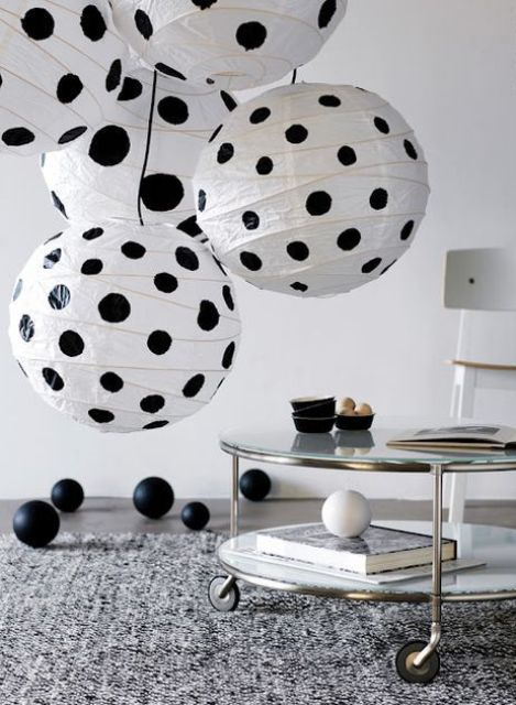 a fun cluster of lamps with black polka dots made of IKEA Regolit lampshades to add fun to your space