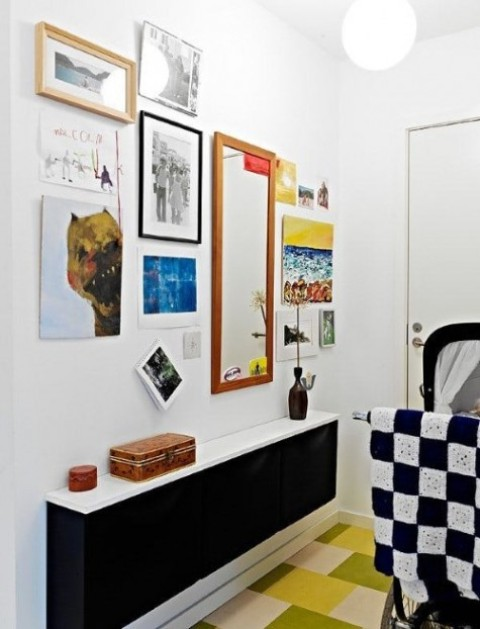 a sleek black IKEA Trones with a white tabletop is a stylish contemporary or minimalist console for an entryway