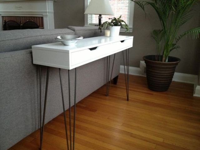 a very slim console table of an Ekby Alex shelf and hairpin legs for a monochromatic space