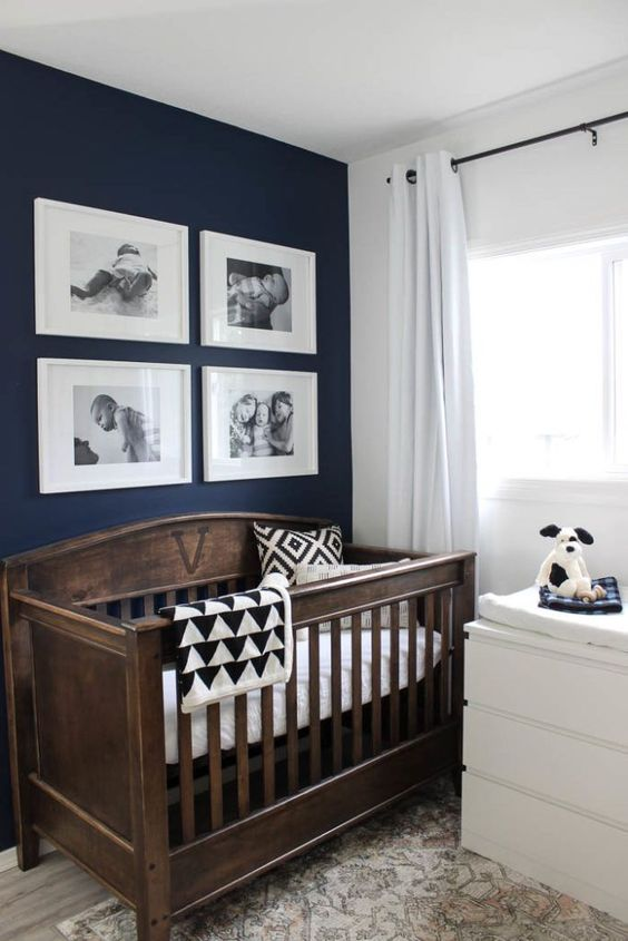 a vintage inspired wooden crib is a chic statement for a nursery and will fit any gender