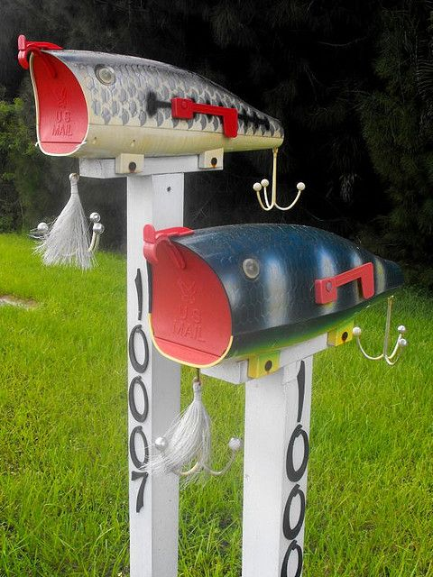 fishy mailboxes with various fishing stuff and house numbers are a fun idea for a coastal or beach home