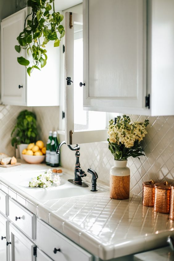 the same tiles for the backsplash and countertops is a whimsy and durable idea to try