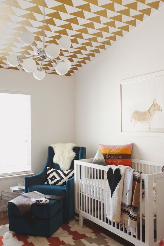 a geometric ceiling in gold and white done with stickers is an easy idea to spruce up a nursery with no fuss
